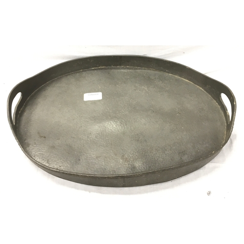 35 - An oval pewter gallery tray - 42cm long....