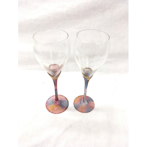 39 - A pair of decorative stemmed wine glasses....