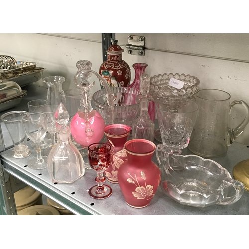 41 - A large collection of clear and cranberry coloured glassware together with an Oriental lidded pot....