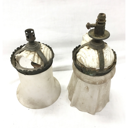 45 - A pair of glass lamp fittings....
