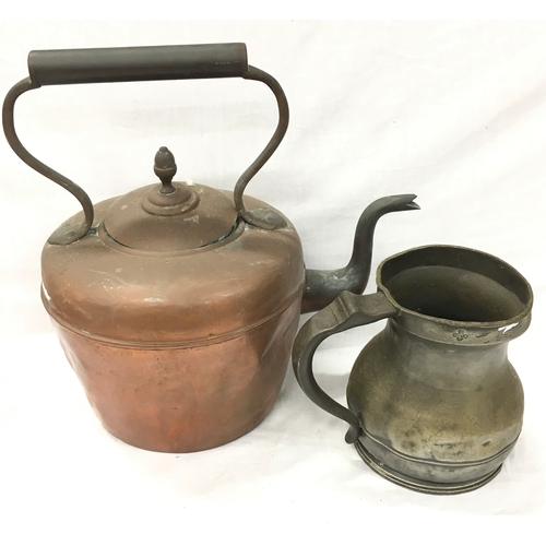 48 - A large copper kettle together with a pewter jug....