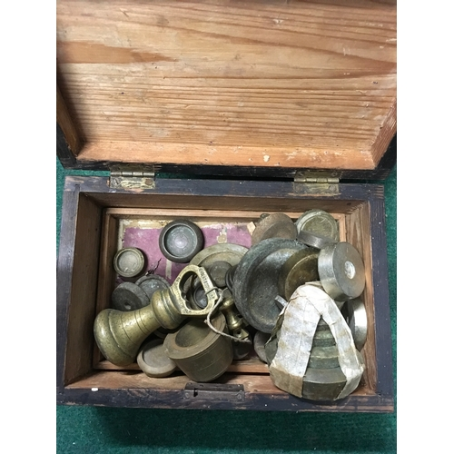 50 - A box with metal weights together with a small wooden