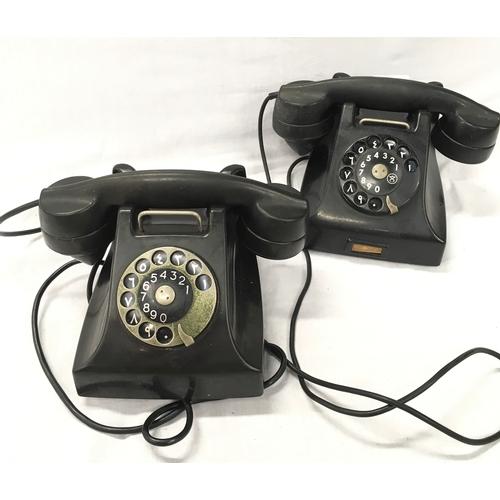 57 - Two black Bakelite telephones....