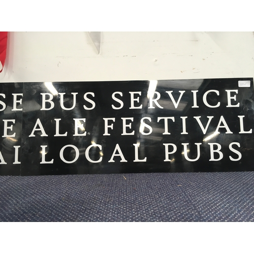 "1003 - Two signs, reading ""Bus service, ale festival, local pubs""...."