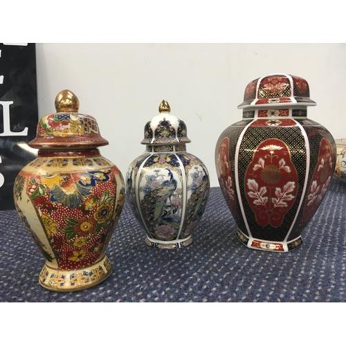 1004 - Three Imari patterned ginger jars....