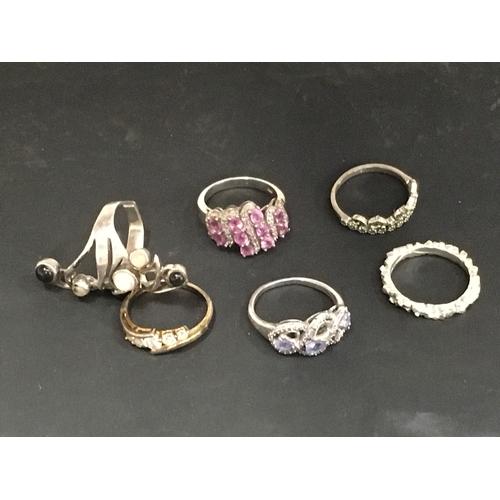 989 - Six silver rings....