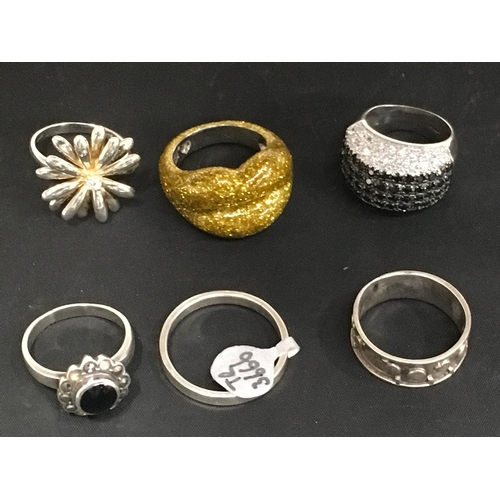 987 - Six silver rings....