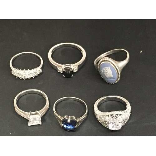 981 - Six silver rings....