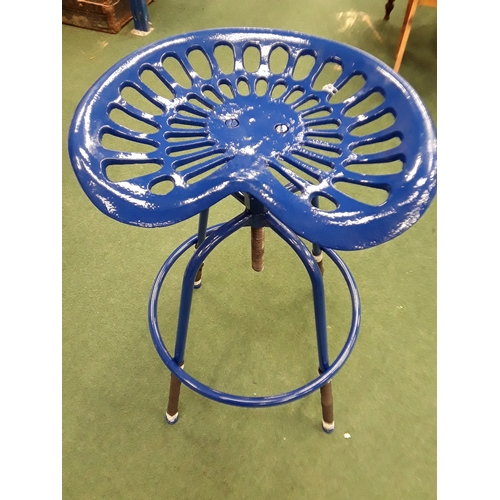 948 - A blue tractor seat stool (106)....