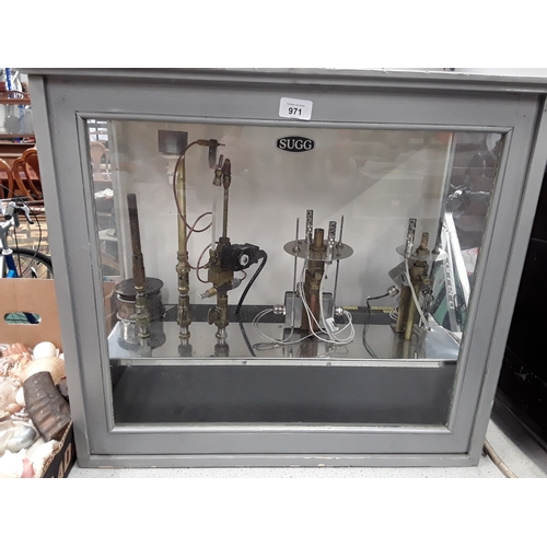 971 - A SUGG glass display cabinet with various gas instruments....