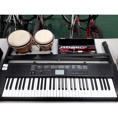 968 - A Casio electronic keyboard with bongo drums and a Venus flute....