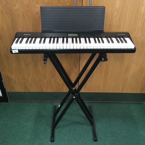 947 - A Roland GO-61P electronic keyboard and stand....