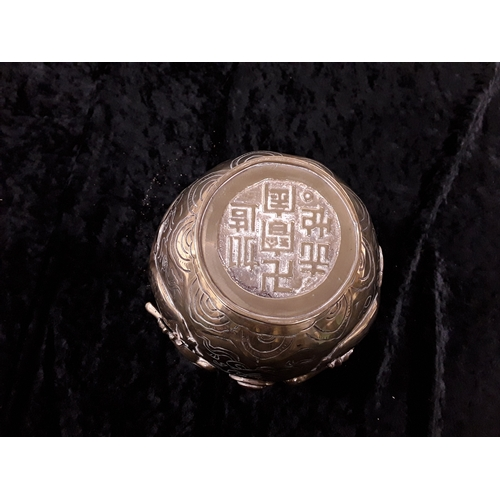 52 - Four Oriental decorative brass pots/vase....