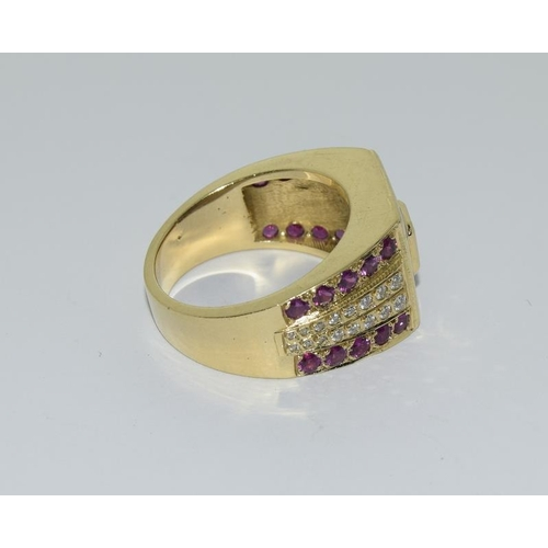 77 - An 18ct gold ring (tested) heavy 23 grams set with Rubies and Diamonds centre stone approx. 80 point...