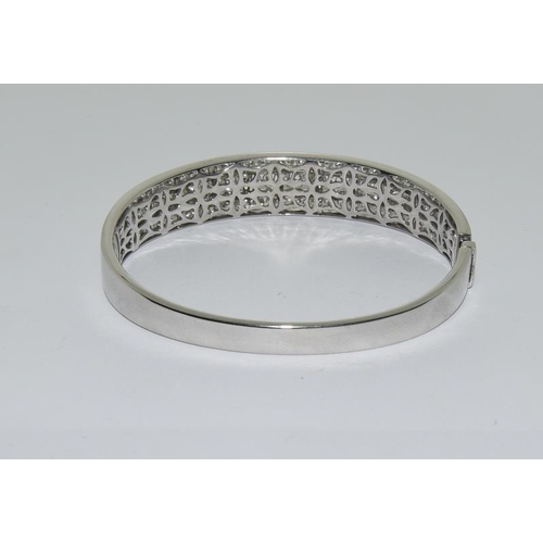97 - A Diamond three lined bangle approx. 5.8ct set in 18ct white gold. (Colourest F/G clarity. Estimate ...