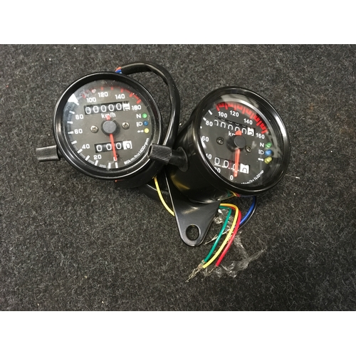 40M - Two motorcycle new speedos....