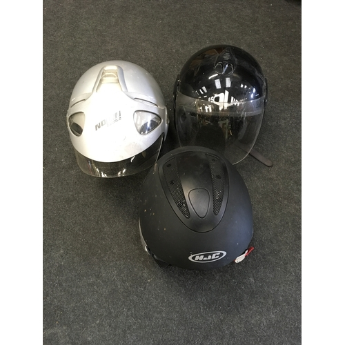 21M - Three assorted motorcycle helmets....