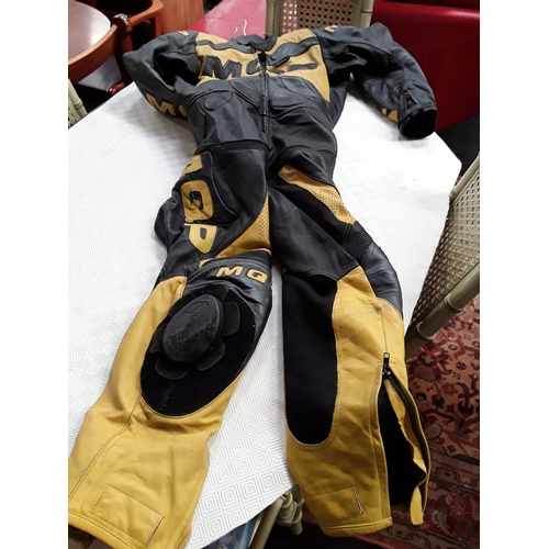 88M - A yellow and black MQP leather motorcycle body suit....