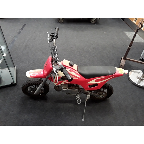 89M - A small childs mini  'Super Dirt' motorbike with flame effect panels....