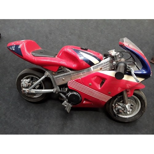 91M - A red childs mini motorbike....