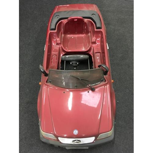92M - A children's toy plastic burgundy Mercedes car....