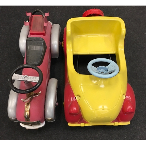 93M - A 'Noddy' style yellow and red plastic pedal car together with a Pompier car....