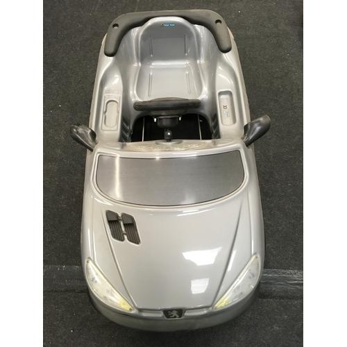 94M - A miniature Peugeot 206 convertible children's car....