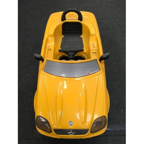 95M - A miniature yellow Mercedes children's car....