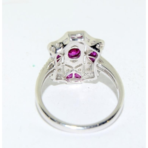 519 - A silver and Ruby Art Deco style ring. Size N....