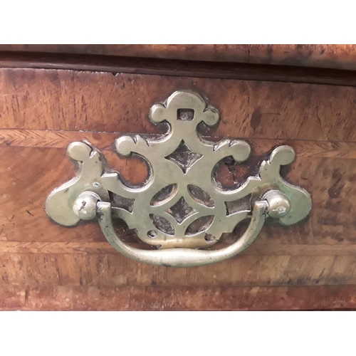 579 - A glass topped walnut Queen Anne four drawer chest of drawers....