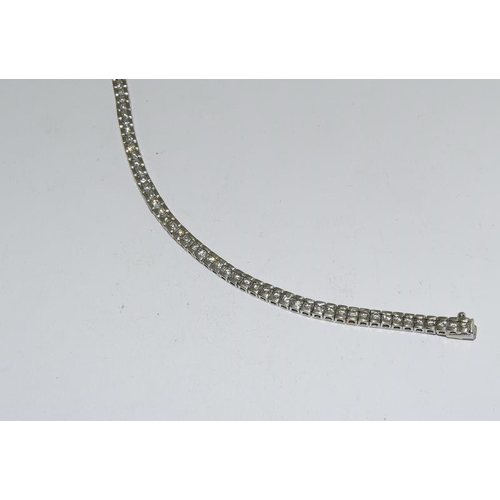 503A - A 3.3 carat diamond line bracelet in 14 carat white gold....