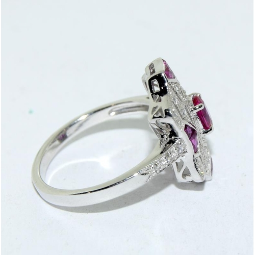 374 - A silver and Ruby Art Deco style ring. Size N....