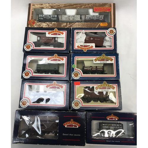 29 - Bachmann OO Gauge boxed rolling stock to include plank wagons, Queen Mary Brake Van Southern Railway...