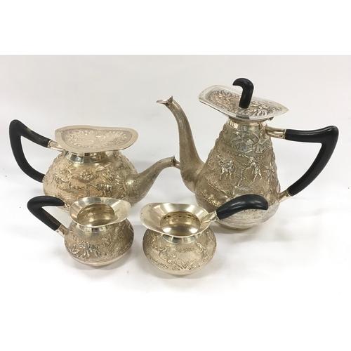 134 - Four piece oriental silver tea set with hot water pot....