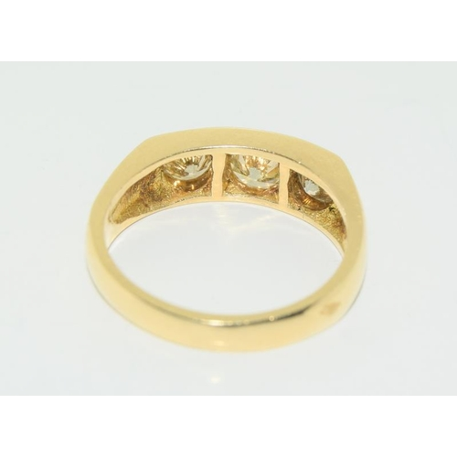 350 - A Gents 18ct yellow gold three stone Diamond ring of 1.9cts. Size U....