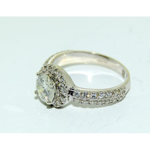 383 - A white gold diamond ring with side diamonds and centre stone approx 1.00ct. Size M....