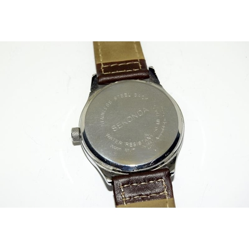 382 - A Sekonda Gents watch with brown leather strap....