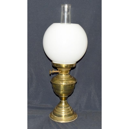 622 - Brass oil lamp and globe...