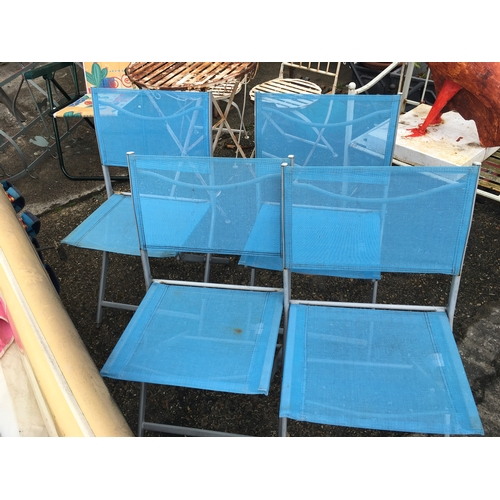 1017 - Four blue metal framed chairs....