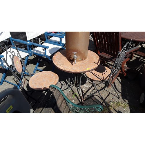 1048 - A garden bistro set comprising of a small table and two chairs....