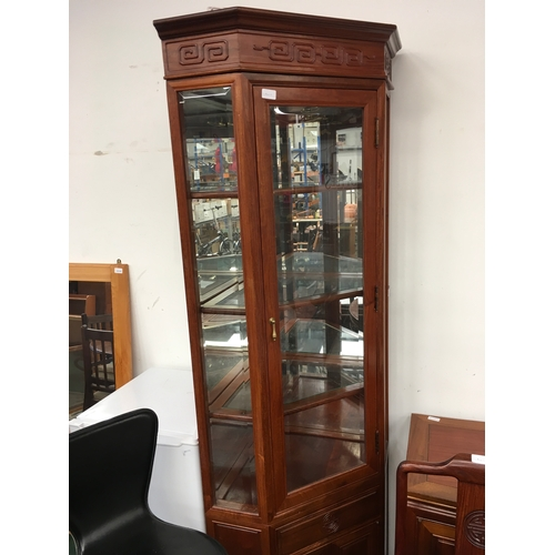 1572 - A two piece corner cabinet. Glass sides and shelves to top, with drawer and cupboard space below....
