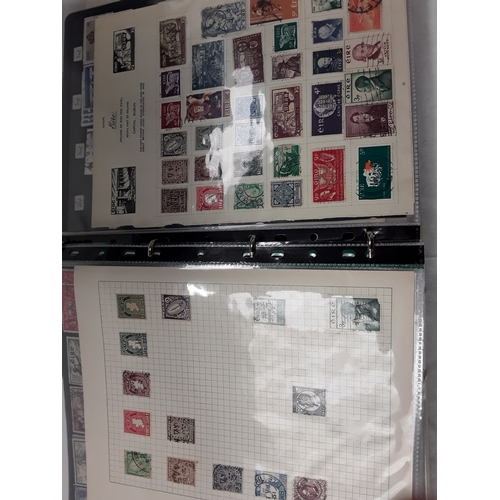 213 - 4 albums with mixed World stamps, a stock book of Queen  Elizabeth II stamps in blocks, and an album...