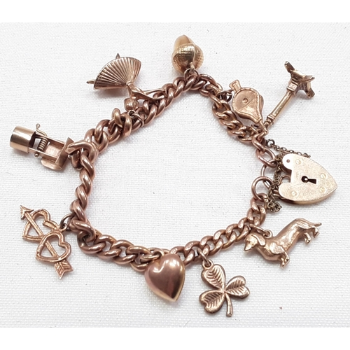 456 - 9ct gold ladies charm bracelet with 9 charms....