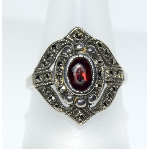 364 - A garnet 925 silver marcasite ring, size P 1/2....