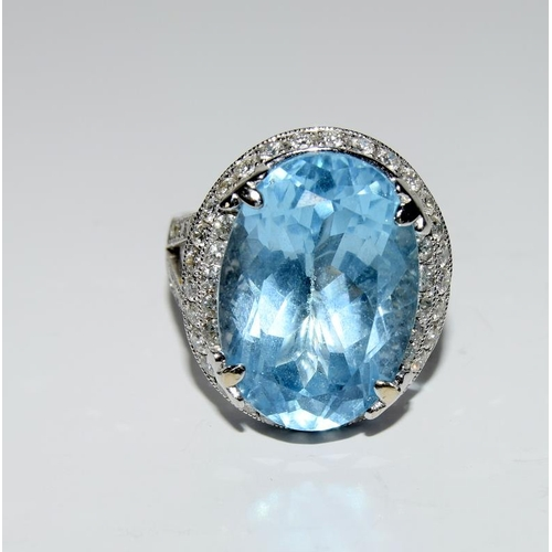 418 - An 18ct white gold substantial blue topaz and diamond ring 24ct approx. Size O...