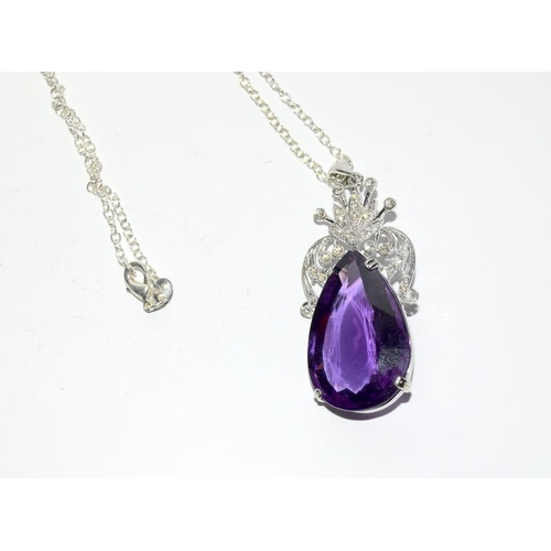 439 - An 18ct white gold impressive amethyst and diamond pendant necklace of 38ct....