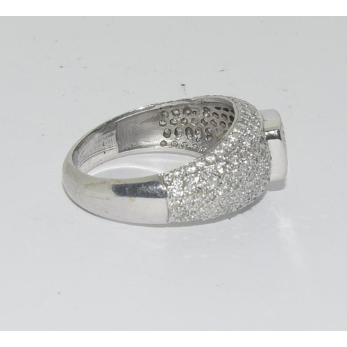 438 - A diamond multi stone gents' ring with large centre stone, approx. 1.06 carats.  Colour estimate. H/...