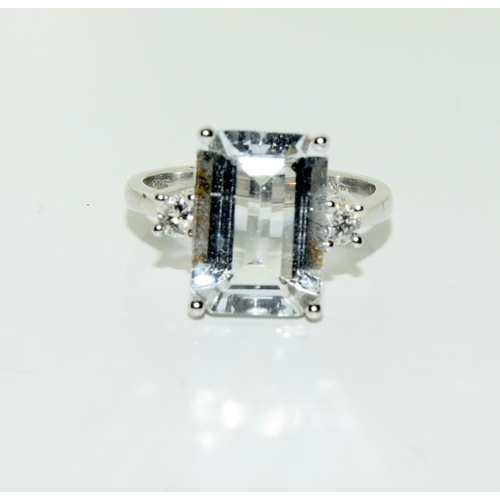 346 - A pale large natural aquamarine and diamond 18ct gold ring, mounted in 18ct white gold....