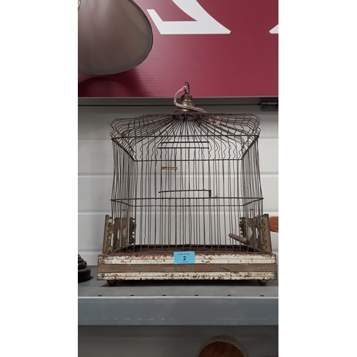 2 - A vintage bird transporting cage....
