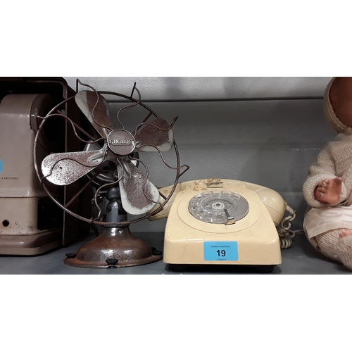 19 - A mid 20th century Gilbert metal desk fan together with a vintage telephone....